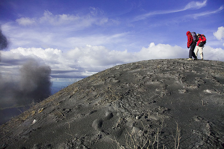 Philip and Peter on the summit of Lengai and ash from an eruption. (Photo: Tom Pfeiffer)