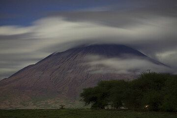 Lengai and the typical cloud around its summit seen in moonlight. (Photo: Tom Pfeiffer)