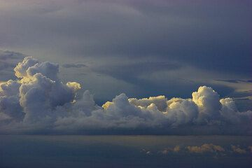 Rain clouds over the RIft Valley illuminated by the evening sun (Photo: Tom Pfeiffer)
