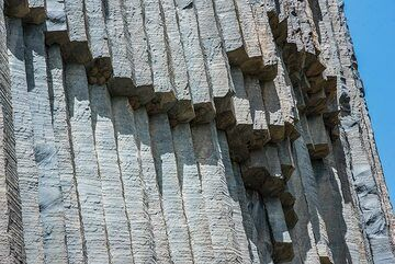 Part of the cliff made of lava columns; at the base of many columns are small birds' nests. (Photo: Tom Pfeiffer)
