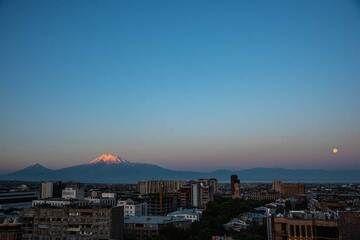 Yerevan city panorama, with full moon setting just before sunrise and Mt Ararat volcano in the background. (Photo: Tom Pfeiffer)