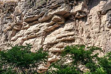 Cliffs of old limestone flank the area of Devil's Bridge where the river is covered by naturally grown travertine. (Photo: Tom Pfeiffer)