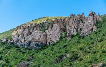 """The """"fairy chimneys"""" of Sisak - ancient volcanic tuffs or ignimbrite (solidified or semi-solidified rock from fragmented volcanic material deposited during hot avalanches from explosive eruptions) have been shaped by erosion into tower- or chimney-like structures, quite similar to the more well-known chimneys in Cappadocia. (Photo: Tom Pfeiffer)"""