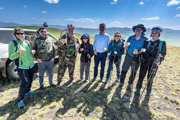 We meet a group of friendly locals who came here to pick-nick, and offer us to taste their lamb and chacha (local brandy). (Photo: Tom Pfeiffer)