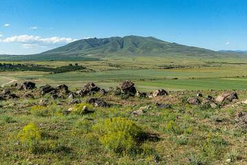 Ara (Arayi Lerr) mountain is a approx. 2 million year-old stratovolcano in the Kotayk Province near the town of Zoravan NW of Yerevan. It reaches 1900 m altitude and has remnants of an eroded crater at its summit. Image taken during a photo stop from the south, on the way to Aragats. (Photo: Tom Pfeiffer)
