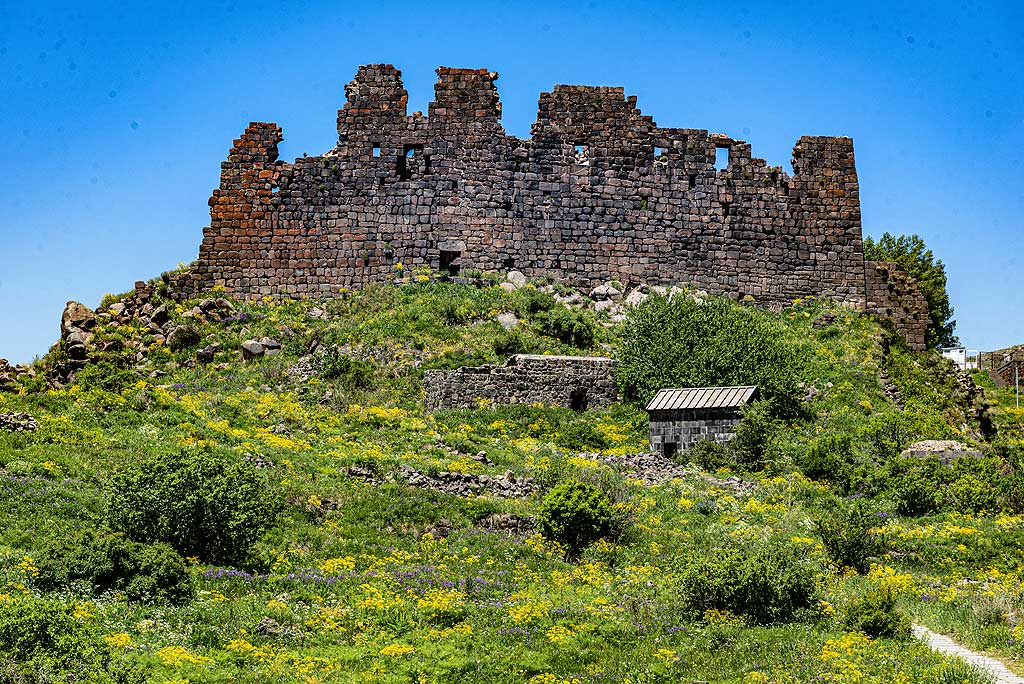 Amberd fortress was built in the 10th century at 2,300 meters (7,500 ft) altitude on the slopes of Mount Aragats where the two canyons of the Arkashen and Amberd rivers meet and form a natural promontory overlooking a vast sector of the slopes of Aragats volcano. (Photo: Tom Pfeiffer)