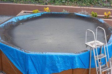 Ash-covered pool in Tajuya. (Photo: Tom Pfeiffer)