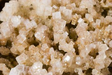 Salt crystals form in hollows where they are protected from wind and the rare rains.  (Photo: Tom Pfeiffer)