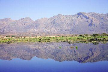 Lake Awash at the bottom of the RIft Valley mirrors Fantale volcano. (Photo: Tom Pfeiffer)