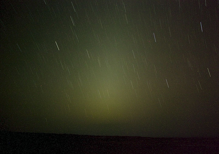 I miss a real film camera... Marco shows us the spectacularly bright zodiacal light on the Western horizon after sunset (light reflected from interplanetary dust). (Photo: Tom Pfeiffer)