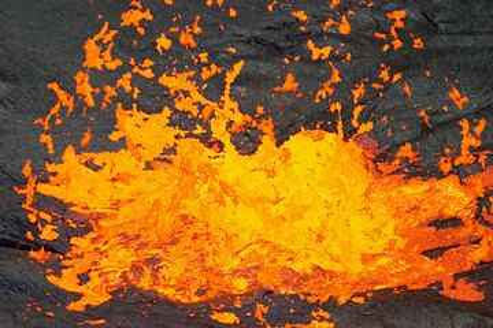 Exploding gas bubble at the lava lake of Erta Ale volcano, Ethiopia (Photo: Tom Pfeiffer)