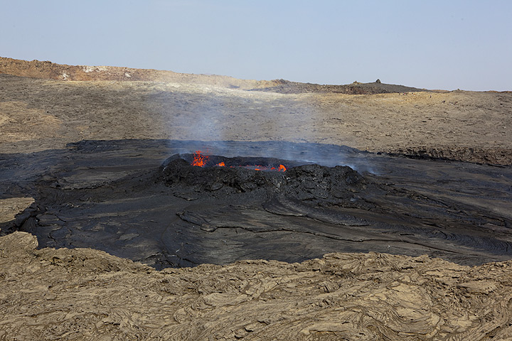 While the lava inside the ring wall is hidden from the northern rim, it is barely visible from the little cinder cone south of the crater. View is to the north across the south crater.  (Photo: Tom Pfeiffer)