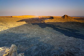 Evening view of Erta Ale's vast caldera with the lava lake that has filled up the south crater. The recent overflows are black on the floor of the caldera. (Photo: Tom Pfeiffer)
