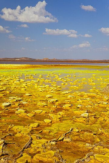 View across a new lake on Dallol towards the site of the old potash mining town (Photo: Tom Pfeiffer)