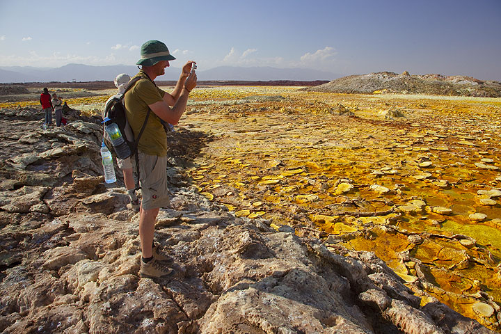 Rude photographing the surreal landscape at Dallol (Photo: Tom Pfeiffer)