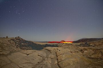 View towards the south crater across a small collapse pit in moonlight. (Photo: Tom Pfeiffer)