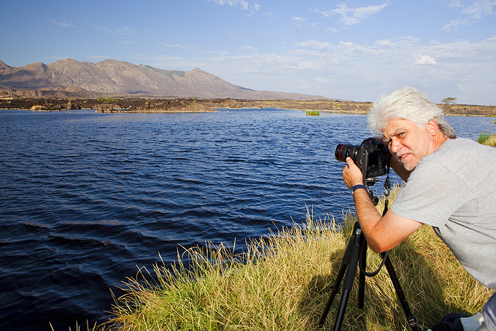 Photographer Roland at Lake Awash with Fantale volcano in the background (Photo: Tom Pfeiffer)