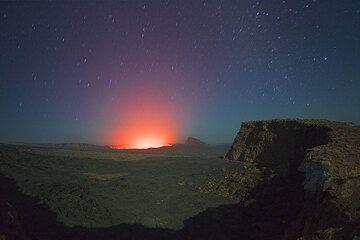 Glow from the active lava lake in Erta Ale'c summit caldera (Photo: Tom Pfeiffer)