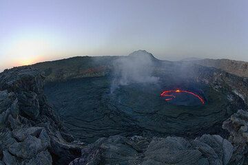 Erta Ale with its concentric crater structure and the active lava lake at sunrise (Photo: Tom Pfeiffer)