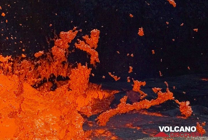 On an enlarged section of the previous image, one can see the formation of Pele's hair - thin threads of lava glass, forming when bubbles burst and tear semi-liquid spatter apart. (c)