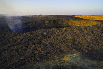 The south crater which contains the active lava lake inside the caldera of Erta Ale volcano at sunset (Photo: Tom Pfeiffer)