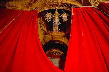 Red curtains inside Abraha Atsbeha church (Photo: Tom Pfeiffer)