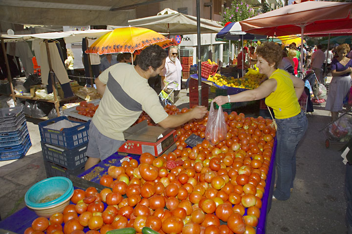 Selling tomatoes - the main ingredient for many Mediterranean dishes (c)