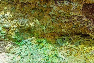 Copper-bearing green fumarolic minerals. (Photo: Tom Pfeiffer)