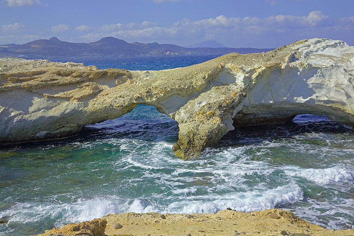 Erosion at the white cliffs has created natural arches over the water. (Photo: Tom Pfeiffer)