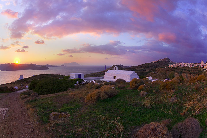 mSunset panorama of Milos with Antimilos island in the background (Photo: Tom Pfeiffer)
