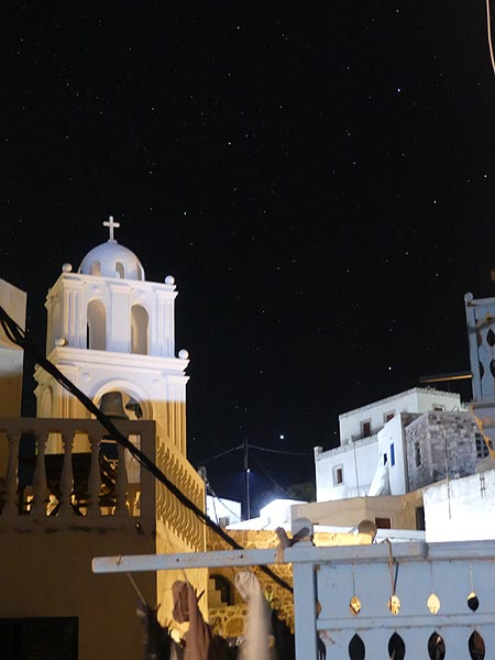 Nightsky in Mandraki with the white dome of an orthodox church and thousands of stars (Photo: Ingrid Smet)