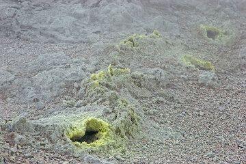 Fumaroles in a row along a hidden fracture. (c)