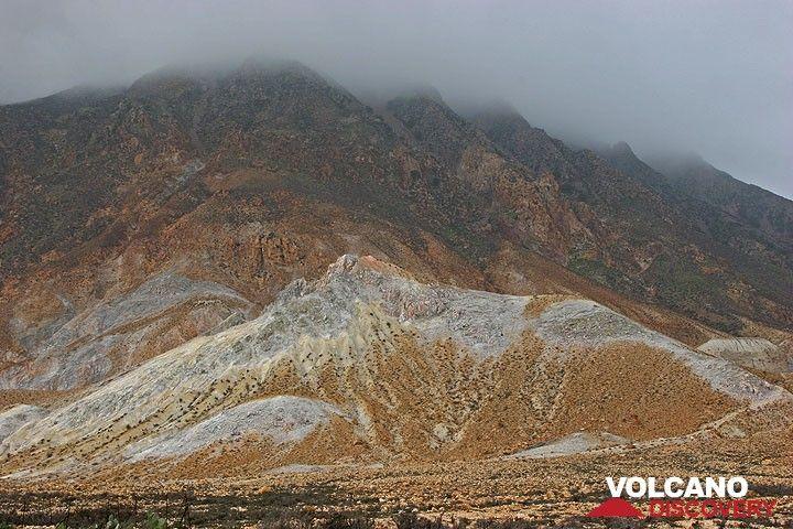 As often, the highest peak of the island, Profitis Ilias mountain is shrouded in fog. (c)