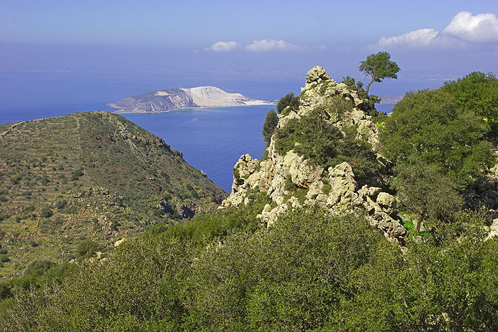 We are near the top of the mountain. The view opens up towards Yali island with its pumice quarry. (c)