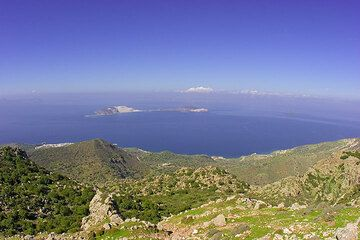The island of Kos is in the far background, forming the rim of the large submerged caldera created by the huge Kos supervolcano explosion around 160,000 years BP. (c)
