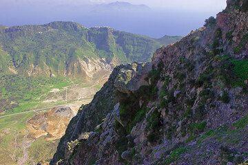 View across the caldera and towards neighboring island of Tilos. (c)