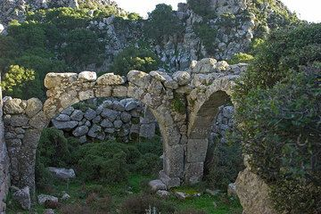 Old arches, beautifully built and still standing after centuries have passed. (c)
