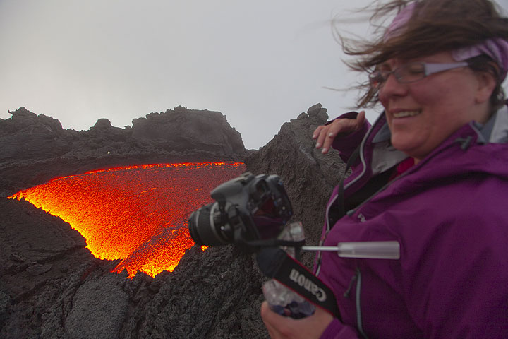 Penny, one of VolcanoDiscovery's biggest fans, at the lava flow in the morning (after a long and wet night out here). (Photo: Tom Pfeiffer)