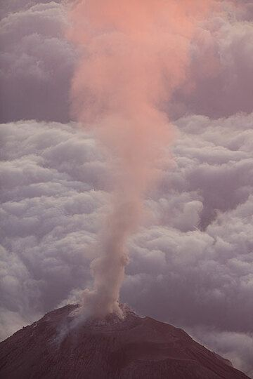 Plume of gas and ash rising from Caliente lava dome at sunset (Photo: Tom Pfeiffer)