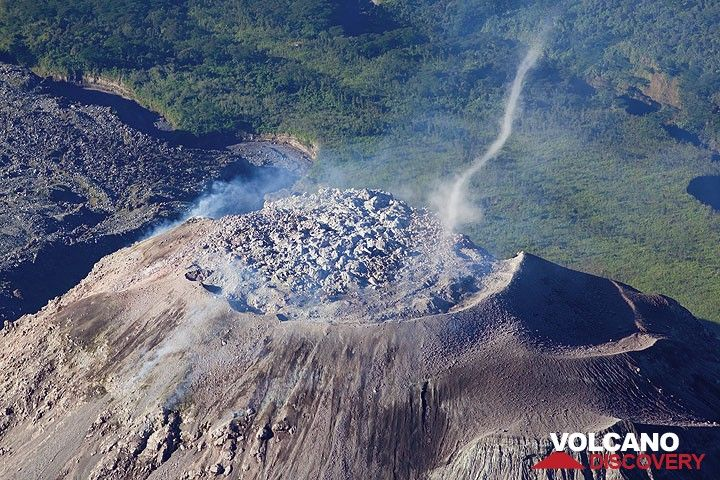 Turbulence creates a dust devil rising ash from the lava dome (Photo: Tom Pfeiffer)