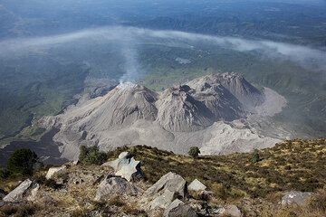 View onto the complex of the 4 overlapping lava domes of Santiaguito from the summit of Santa Maria volcano. (Photo: Tom Pfeiffer)