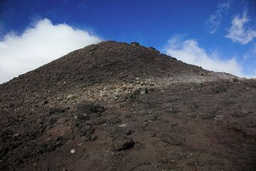The summit cone of Pacaya volcano seen from the vast lava flow field created in the 2006 eruption. (Photo: Tom Pfeiffer)