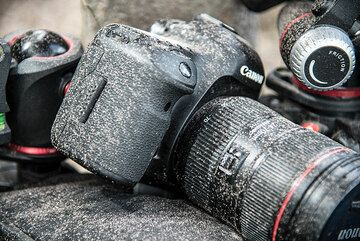 ... and soon feel the effects of ash fall on our gear. (Photo: Tom Pfeiffer)