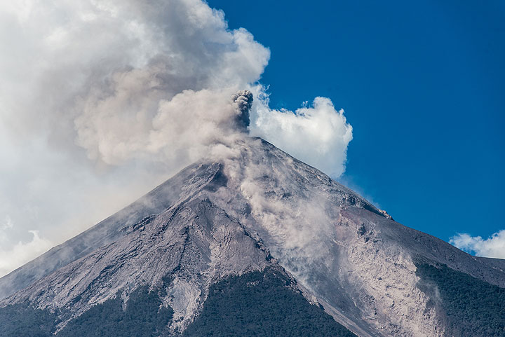 View of Fuego from the east on 31 Dec 2015: the prominent ravine is one of the main channels of pyroclastic flows into the Las Lajas and San Antonio canyons further downslope. (Photo: Tom Pfeiffer)