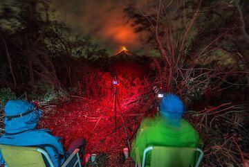 Britta and Markus enjoying the view of the volcano. (Photo: Tom Pfeiffer)