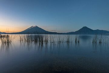View of Toliman and San Pedro volcanoes from the lake shore at dawn. (Photo: Tom Pfeiffer)