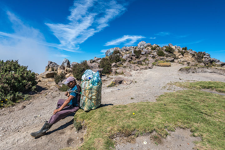 One of our porters resting at the summit. (Photo: Tom Pfeiffer)