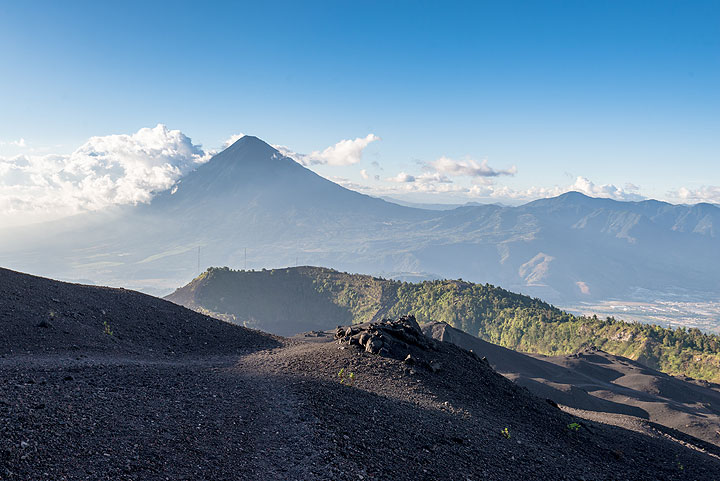 View to the north with the caldera rim of Pacaya in middle and the majestic silhouette of Agua stratovolcano in the far background. (Photo: Tom Pfeiffer)