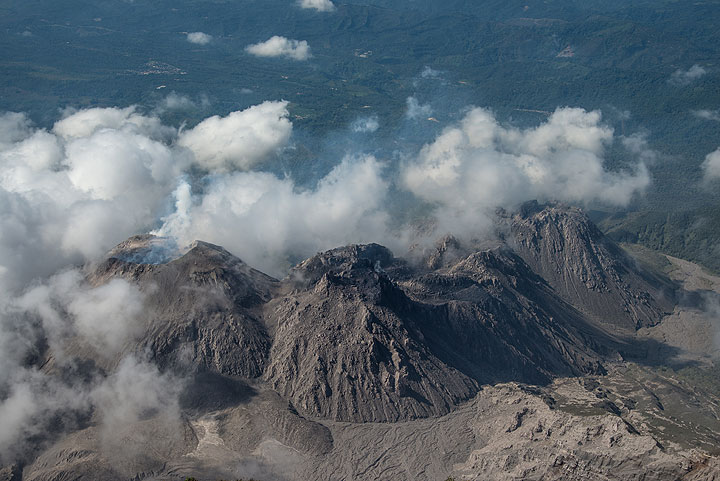 The Santiaguito lava dome complex with its 4 domes seen from the summit of Santa Maria volcano. From l to r, these are: Caliente (currently active), La Mitad, El Monje, and El Brujo. (Photo: Tom Pfeiffer)