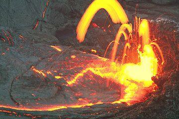 Lava spattering from the vent in Kilauea's Pu'u 'O'o crater, feeding a lava lake. (Photo: Tom Pfeiffer)
